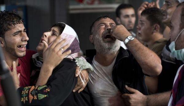 Palestinian mourners cry at Gaza City's al-Shifa hospital after an explosion killed at least seven children in a public playground in the beachfront Shati refugee camp on July 28, 2014.  Photo by AFP
